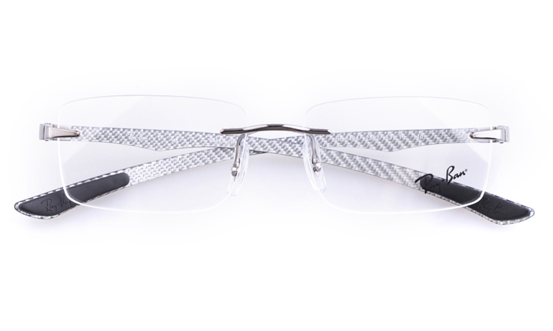ray ban rimless titanium eyeglass frames  these eyeglasses frames come in shiny black acetate with the rayban logo featured on the temples. spring hinges give added comfort for the wearer.